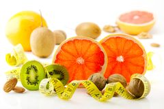 Healthy food, nutrition and diet. New trends and prospects in fitness, healthy lifestyle, sports nutrition. Ripe and mouth-watering tropical fruits and nuts Royalty Free Stock Images