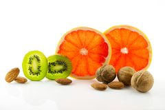 Healthy food, nutrition and diet. New trends and prospects in fitness, healthy lifestyle, sports nutrition. Ripe and mouth-watering tropical fruits and nuts Stock Image