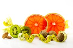 Healthy food, nutrition and diet. New trends and prospects in fitness, healthy lifestyle, sports nutrition. Ripe and mouth-watering tropical fruits and nuts Stock Photo