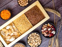Healthy food nutrition dieting concept. Assortment of high vitamin E sources. nuts, seeds, beans, buckweat, lentils, chickpea,. Healthy fats concept royalty free stock image