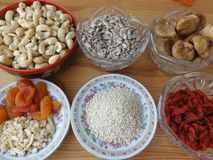 Healthy food nuts and berries. Healthy food: cashews, sunflower seeds, figs, sesame seeds, goji berries, dried apricots stock photo
