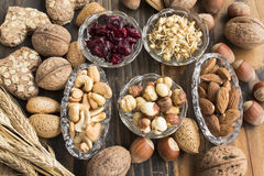 Healthy Food, Nuts, Wheat Germ, Whole Wheat Cookies and Cranberr. Ies no Rustic Wooden Table Stock Images