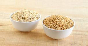 Healthy Food Oats and Steel-cut Oats in Bowls stock images