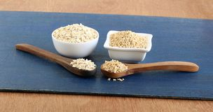 Healthy Food Oats and Steel-cut Oats on Wooden Spoons stock photo