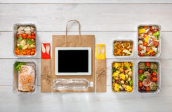 Healthy food online order in boxes, top view at wood. Healthy restaurant food internet online order background. Eating right. Fresh diet daily meals delivery Stock Image