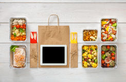 Healthy food online order in boxes, top view at wood. Healthy restaurant food internet online order background. Eating right. Fresh diet daily meals delivery Royalty Free Stock Photo