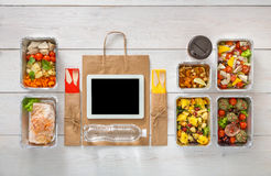 Healthy food online order in boxes, top view at wood. Healthy restaurant food internet online order background. Eating right. Fresh diet daily meals delivery Stock Photo