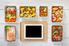 Healthy food online order in boxes, top view at wood. Healthy restaurant food internet online order background. Eating right. Fresh diet daily meals delivery Stock Photos