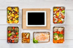 Healthy food online order in boxes, top view at wood. Healthy restaurant food internet online order background. Eating right. Fresh diet daily meals delivery Royalty Free Stock Image