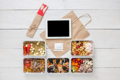Healthy food online order in boxes, top view at wood. Healthy restaurant food, mockup for internet online order background. Fresh diet daily meals delivery Royalty Free Stock Photo