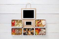 Healthy food online order in boxes, top view at wood. Healthy restaurant food, mockup for internet online order background. Fresh diet daily meals delivery Stock Images