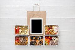 Healthy food online order in boxes, top view at wood. Healthy restaurant food, mockup for internet online order background. Fresh diet daily meals delivery Royalty Free Stock Image