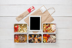 Healthy food online order in boxes, top view at wood. Healthy restaurant food, mockup for internet online order background. Fresh diet daily meals delivery Royalty Free Stock Photography
