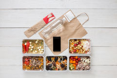 Healthy food online order in boxes, top view at wood. Healthy restaurant food, mockup for internet online order background. Fresh diet daily meals delivery Royalty Free Stock Photos