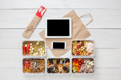 Healthy food online order in boxes, top view at wood. Healthy restaurant food, mockup for internet online order background. Fresh diet daily meals delivery Royalty Free Stock Images