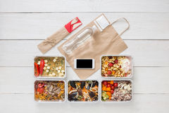 Healthy food online order in boxes, top view at wood. Healthy restaurant food, mockup for internet online order background. Fresh diet daily meals delivery Stock Image