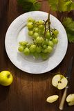 Healthy Food; organic fresh juicy grape and apple on a table stock photography