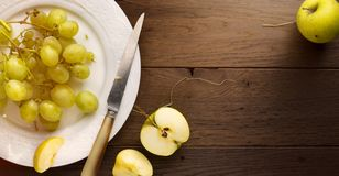 Healthy Food; organic fresh juicy grape and apple on a table royalty free stock images