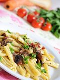 Healthy food - pasta. Close up pasta with mushrooms, bacon  and parsil Royalty Free Stock Photos