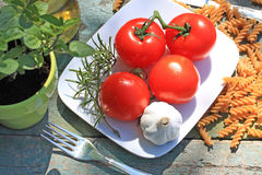 Healthy food, pasta and tomatoes Royalty Free Stock Photos