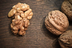 Healthy food of pecan nuts and whole nuts on wooden background stock photography