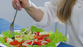 Healthy food, plate of green salad close-up that is eating women at table. Healthy food, plate of green salad close-up that is eating women sitting at table stock footage