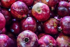 Healthy food, pomegranates background Garnets.  stock photo