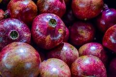 Healthy food, pomegranates background Garnets.  royalty free stock photography