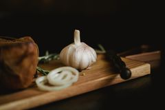 Healthy food with pranami spices and herbs, onion and garlic. Food photo for recipe or cookbook. Wooden black backround.  Stock Photos