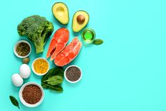 Omega-3 source concept. Healthy food products which are rich source of Omega3 fats, healthy eating concept, blank space for a text, view from above royalty free stock photo