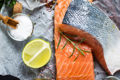 Fresh Raw Salmon Fillet and Ingredients for Cooking. Healthy Food. Raw Salmon Steaks and Ingredients for Cooking Stock Image
