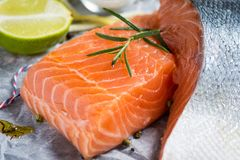 Fresh Raw Salmon Fillet and Ingredients for Cooking. Healthy Food. Raw Salmon Steaks and Ingredients for Cooking Stock Photo