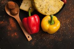 Healthy food. Recipe of italian cuisine. Gourmet sorts of cheese with sweet pepper on spicy black background Royalty Free Stock Photos