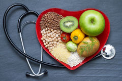 Healthy food on red heart plate Stock Photo