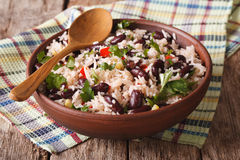 Healthy food: rice with red beans in a bowl close-up. horizontal. Healthy food: rice with red beans in a bowl close-up on the table. horizontal royalty free stock image