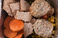 Healthy food, rusks, cutlets, corn, carrot, green pea royalty free stock image