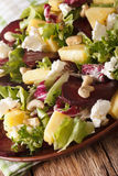 Healthy food: salad of beets, pineapple, goat cheese and greens Royalty Free Stock Image