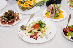 Healthy food salad with vegetables and tuna fish. Salad with salmon, caviar, vegetables and quail eggs. Stock Photos