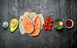 Healthy food. Salmon with organic food royalty free stock image