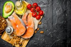 Healthy food. Salmon with organic food stock photography