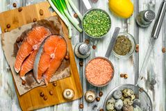 Healthy food. Salmon with organic vegetables, fruits and nuts stock photo