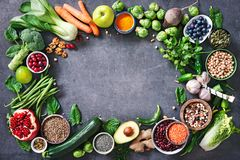 Healthy food selection with fruits, vegetables, seeds, super foods, cereals stock photography