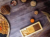 Healthy food. Selection of good carbohydrate sources, high fiber rich food. Low glycemic index diet. cereals, legumes, nuts, dried. Fruits. Wooden background royalty free stock photography