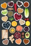 Healthy Food Selection to Slow the Ageing Process. Healthy food to slow the ageing process concept including fruit, vegetables, fish, seeds, spice, dairy, honey royalty free stock images