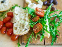 Healthy food set consisting of fresh sandwich with cherry-tomato Stock Photos