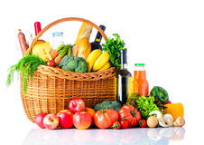 Healthy Food Shopping Isolated on White. Healthy food shopping. A basket full with shopping products and ingredients. organic vegetables and fruits. Isolated on Royalty Free Stock Image