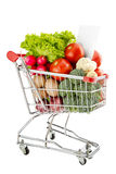 Healthy food shopping list. Shopping trolley full of fresh vegetables isolated on a white background Royalty Free Stock Photos