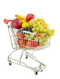 Healthy food shopping. Shopping trolley full of fresh fruits isolated on a white background Royalty Free Stock Image