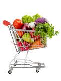 Healthy food shopping. Shopping trolley full of fresh vegetables isolated on a white background Stock Photography