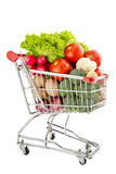 Healthy food shopping. Shopping trolley full of fresh vegetables isolated on a white background Stock Image